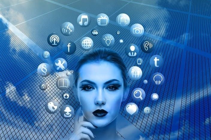 woman-with-social-media-network-icons-surrounding-her-head