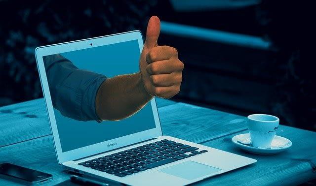 thumbs-up-through-computer-screen