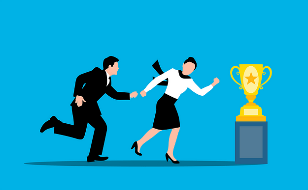 woman-pulling-a-man-to-the-yellow-cup-which-is-the-prize-of-success